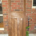The red pine door was stripped in caustic.