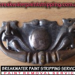 Metal drop handle stripped in non-caustic